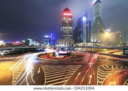 Long exposure photo to dazzling rainbow overpass highway night scene in Shanghai - stock photo