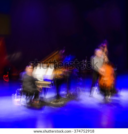 long exposure piano and bass fiddles players - stock photo