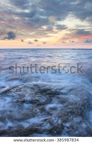 Long exposure sea and rocks at twilight