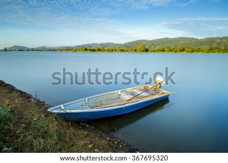 Long Exposure shot of Fisherman Boat located at a Lake in Malaysia after Sunrise. Soft Focus, Motion blur due to long exposure shot. vibrant colors.