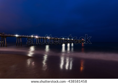 Long Exposure shot of Hermosa Beach pier and light reflections at nighttime, Los Angeles, California, United States - stock photo