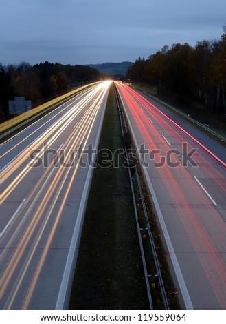 Long exposure shot of highway at night. - stock photo