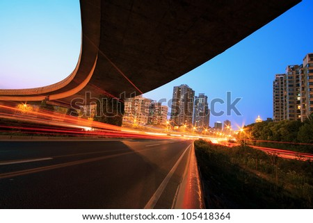 Long exposure shot of Highway viaduct vehicle night scene - stock photo