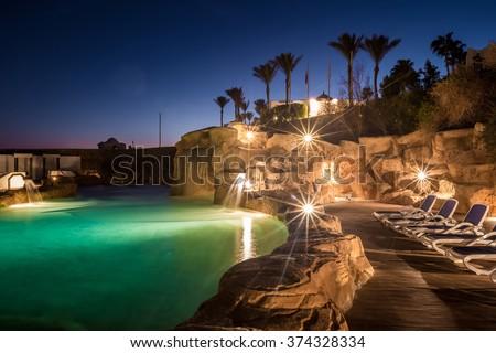 Long exposure shot of swimming pool at luxury night illumination  - stock photo