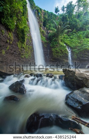 Long Exposure Shot of Water Stream at Waterfall Near the Village. Soft Focus Motion Blur due to Long Exposure Shot