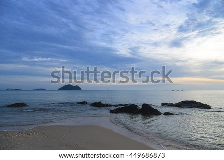 Long exposure shot over the Silhouette image of the Gulf of Thailand at Songkhla Thailand during sunrise.