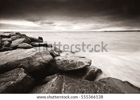 Long exposure. Stormy skies at Sunken Meadow. Black and white. Monochrome processed  - stock photo