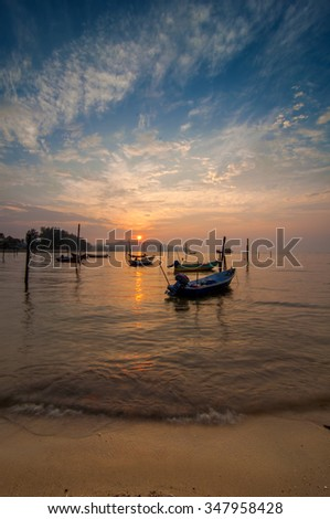 Long Exposure Sunrise Seascape with Fisherman Boat on the Sea (Soft focus, shallow DOF, slight motion blur)