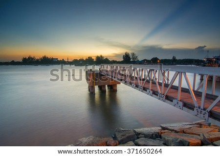 Long Exposure Sunset Near The River. Soft Focus, Motion Blur due to Long Exposure Shot