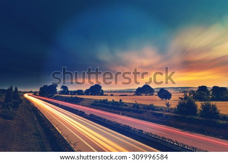 Long-exposure sunset over a highway with instagram vintage old effect - stock photo