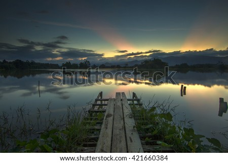 Long Exposure Sunset Seascape with Abandon Jetty. Soft Focus, Motion Blur Due to Long Exposure Shot Copy Space Area - stock photo