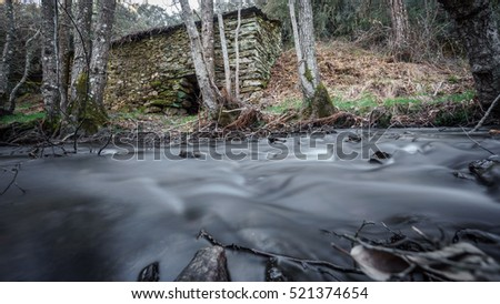 Long exposure with vintage waterwheel and silk water
