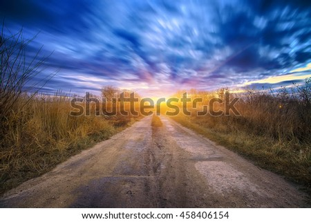 Long exposure work during sunrise. Motion of clouds. plates of the road - stock photo