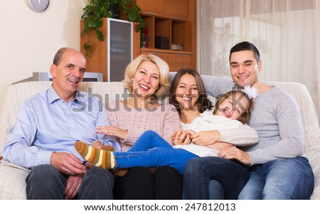 Long family with grand children posing indoors