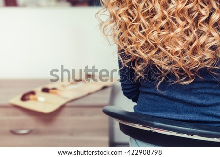 Long female blond curly hair - stock photo
