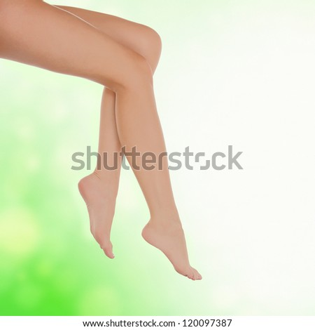 Long female legs after depilation, abstract blurred background