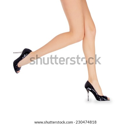 Long female legs in black shoes over white - stock photo