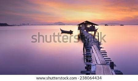 Long fishing pier at Jelutong Penang, Malaysia. - stock photo