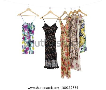 Long flower skirt an sundress on a wooden hanger - stock photo
