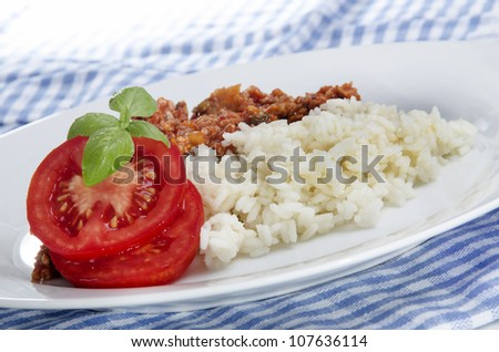 Long grain rice with minced meat, basil and tomato - stock photo