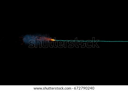 Long green fuse burning on black background isolated