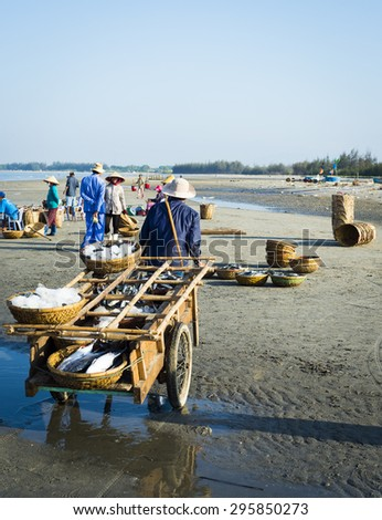 LONG HAI, VIET NAM - May 31,2014: People working at a wholesale fish market, they get fresh fish directly from fishing boats at Long Hai township, Ba Ria - Vung Tau province, Vietnam