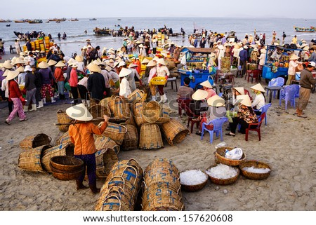 LONG HAI, VIETNAM, MARCH 15: A traditional fish market on the beach on March 15, 2008 in Long Hai, Vung Tau, Vietnam. This market only happens in early morning. - stock photo