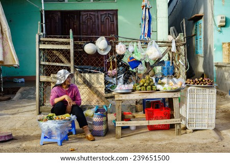 LONG HAI, VUNG TAU, VIETNAM - DEC 21, 2014. Vietnamese fast food street vendor at Long Hai fish market in early morning. The local market only happens in early morning. - stock photo