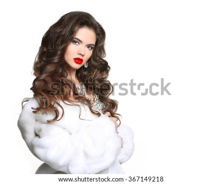 Long hair. Beautiful Woman in Luxury white mink Fur Coat. Fashion jewelry accessories. Beauty Makeup. Elegant lady isolated on white background. - stock photo