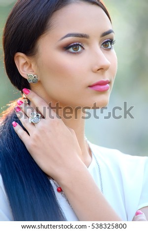 long hair beautiful woman. Model with luxury accessory and jewelry. Close-up beauty portrait