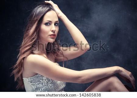 long hair beautiful young woman studio shot - stock photo