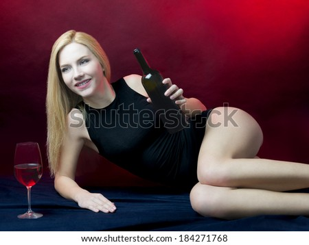 long hair blond beauty woman wearing black underwear drinking red wine  - stock photo