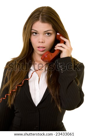 Long hair brunette business woman with dumbfounded or speechless expression holding a red telephone receiver - stock photo