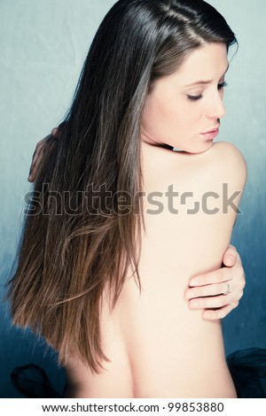 long hair brunette woman beauty portrait back studio shot