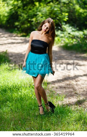 Long - hair girl at forest - stock photo