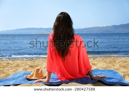 Long Hair Girl is Relaxing Near The Sea - stock photo