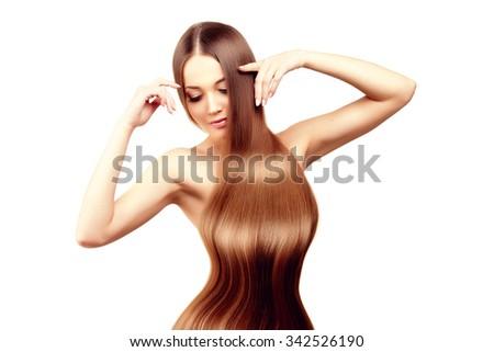Long hair. Hairstyle. Hair Salon. Fashion model with shiny hair. Woman with healthy hair girl with luxurious haircut. Hair loss - stock photo