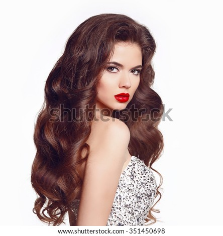 Long hair. Makeup. Beautiful girl portrait. Brunette fashion woman with red lips and healthy wavy shiny hairstyle posing isolated on white studio background.