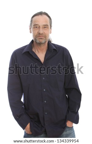 Long hair man wearing black long sleeve with hands on his pocket - stock photo