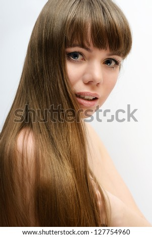 long hair of pretty young woman - stock photo