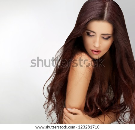 Long Hair. Portrait of Beautiful  Woman with Long Brown Hair. Good quality retouching. - stock photo