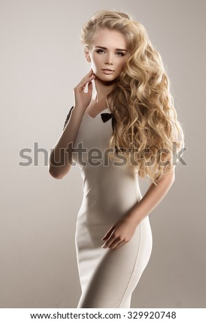 Long hair. Waves Curls Hairstyle. Hair Salon. Updo. Fashion model with shiny hair. Woman with healthy hair girl with luxurious haircut. Hair loss Girl with hair volume.  - stock photo