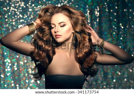 Long hair. Waves Curls Hairstyle. Hair Salon. Updo. Fashion model with shiny hair. Woman with healthy hair girl with luxurious haircut. Hair loss Woman with hair volume.  - stock photo