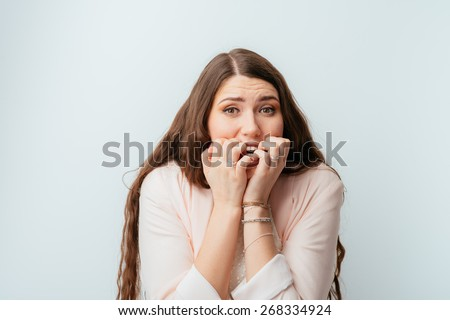 long-haired beautiful young brunette woman fears - stock photo