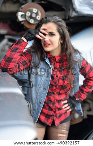 long-haired brunette girl posing in a car scrap page