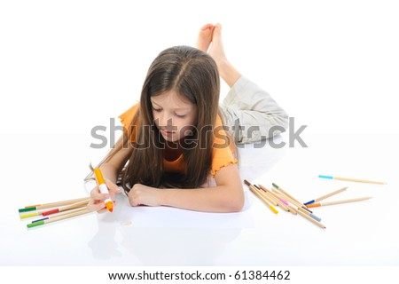 Long-haired girl draws. Isolated on white background - stock photo