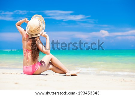 long haired girl in bikini on tropical tthailand beach