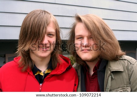Long-Haired Teen Brothers - stock photo