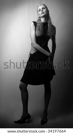 Long-haired young girl in black dress, closeup studio shot
