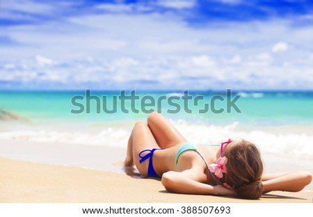long haired young woman in bikini and sunglasses on tropical beach. remote tropical beaches and countries. travel concept